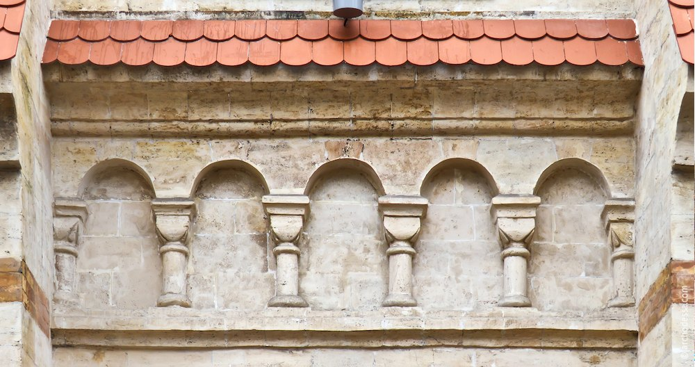 A panel over the first tier windows