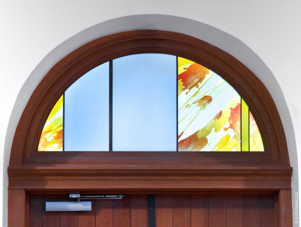 Stained glass transom of the side entrance