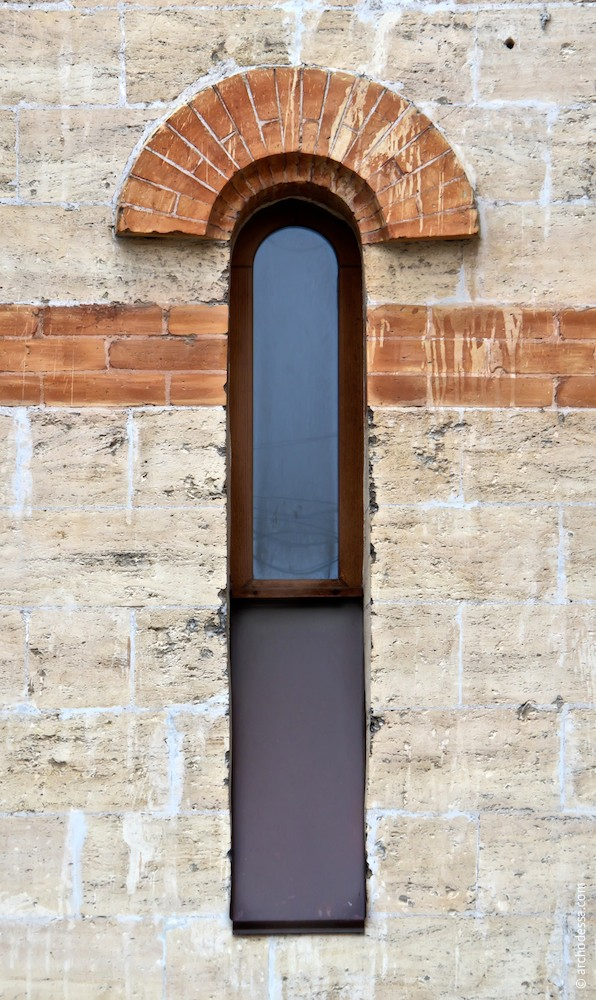 Window of the stair tower lower tier and brick inserts of the masonry