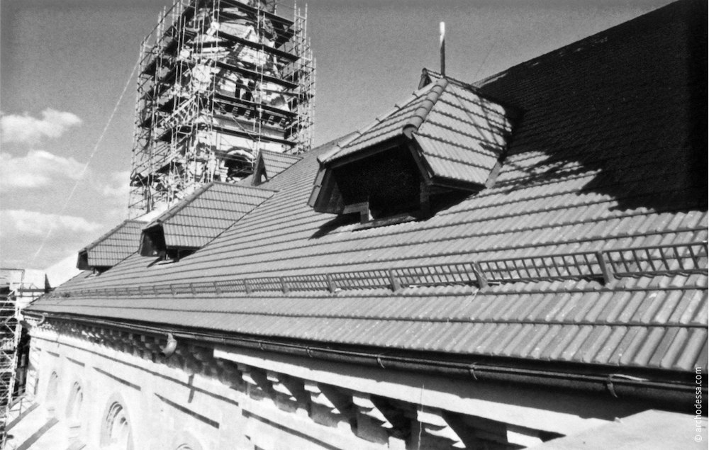 A view of the restoring steeple and the new roof from the new wing roof