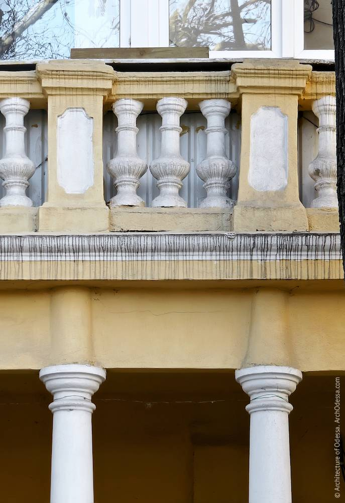 Columns and a fragment of the balcony balustrade