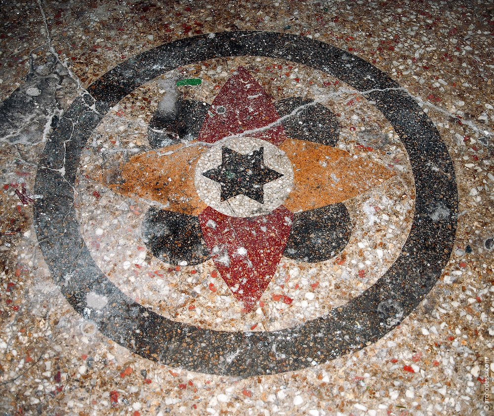 Concrete-mosaic ornament at the stairs foot